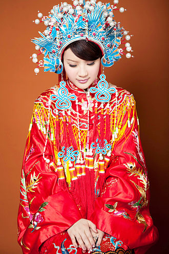 Wedding dress - Qing dynasty styled traditional Chinese wedding dress with phoenix crown (鳳冠) headpiece still used in modern Taiwanese weddings.