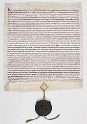 Manuscrit en vieux français, scellé du sceau de Henri III en cire verte sur cordonnets de soie rouge et verte.