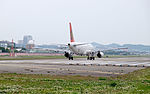 TransAsia Airways Airbus A320-232 B-22311 Stand by at Taipei Songshan Airport Runway 20150221.jpg