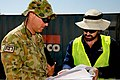 Travis Collins, right, the environmental officer with the Force Extraction Unit at Multinational Base Tarin Kowt, and Australian Army Sgt. Thomas Allison, a surveyor with the unit, record soil samples for 130704-O-MD709-017-AU.jpg