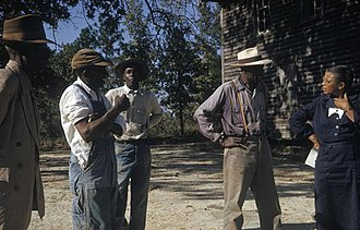 Tuskegee syphilis experiment - Subjects talking with study coordinator, Nurse Eunice Rivers, c.1970