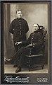 Två män i uniform. En stående, den andre sittande. Ateljébild - Nordiska Museet - NMA.0048892.jpg