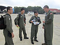 U.S. Air Force Lt. Col. Tim Murphy, right, a C-130 Hercules aircraft pilot with the North Carolina Air National Guard, speaks with his aircrew counterparts with the Royal Malaysian Air Force before the first 130603-F-ZZ999-003.jpg