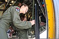 U.S. Air Force Senior Airman Heather Burdette, assigned to the 43rd Electronic Combat Squadron (ECS), shows Dana Morgan, a 9-year-old honorary Pilot for a Day, how to close the back ramp of an EC-130H Compass 140314-F-ZT877-387.jpg