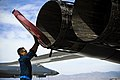 U.S. Air Force Staff Sgt. Kevin Colon, a crew chief assigned to the 7th Aircraft Maintenance Squadron, removes exhaust covers from a B-1B Lancer aircraft during exercise Green Flag-West May 21, 2013, at Nellis 130521-F-OS776-038.jpg