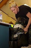 U.S. Air Force Staff Sgt. Sara Rowley, of the 48th Logistics Readiness Squadron, 48th Fighter Wing, puts on mission oriented protective posture 2 gear during a chemical warfare training class at Royal Air Force 061109-F-ZM185-001.jpg