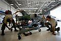 U.S. Airmen with a weapons standardization crew with the 33rd Maintenance Group returns a GBU-12 Paveway II laser-guided bomb to its cradle after loading it onto an F-35A Lightning II aircraft Aug. 27, 2013 130827-F-OC707-004.jpg
