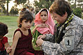 U.S. Army Capt. Marie Orlando, a public affairs officer with an agriculture development team, weaves a friendship bracelet for an Afghan girl during a Girl Scout meeting at Forward Operating Base Finley Shields 100821-F-FW394-233.jpg