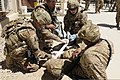 U.S. Army medics with Task Force Lifeliner treat a simulated leg injury June 7, 2013, during mass casualty training at Bagram Airfield in Afghanistan 130607-A-ZT122-042.jpg