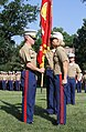 U.S. Marine Corps Maj. Brandon J. Gorman, left, receives the Marine Corps Recruiting Station Raleigh colors from Maj. Jennifer A. Nash, during a change of command ceremony at North Carolina State University 120620-M-EK802-033.jpg