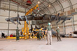 U.S. Marines with Marine Attack Squadron (VMA) 211 replace the wings of an AV-8B Harrier II aircraft at Camp Bastion in Helmand province, Afghanistan, Sept 120903-M-EF955-059.jpg