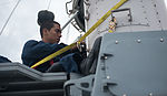 U.S. Navy Fire Controlman 3rd Class Juan Jimenez conducts routine maintenance on a close-in weapons system aboard the amphibious transport dock ship USS Denver (LPD 9) in the East China Sea March 9, 2014 140309-N-IC565-036.jpg