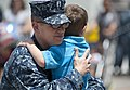 U.S. Navy Lt. Jason Constantine hugs his son May 14, 2013, before departing from Naval Base San Diego aboard the amphibious dock landing ship USS Pearl Harbor (LSD 52) to participate in Pacific Partnership 2013 130514-N-SK590-165.jpg
