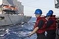 U.S. Sailors aboard the guided missile cruiser USS Vella Gulf (CG 72) in the Mediterranean Sea prepare to execute a replenishment at sea with the fleet replenishment oiler USNS Leroy Grumman (T-AO 195) Aug. 27 140827-N-ZE250-049.jpg
