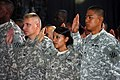 U.S. troops take the citizenship oath during a naturalization ceremony in Al Faw Palace on Camp Victory, Iraq, July 4, 2010.jpg