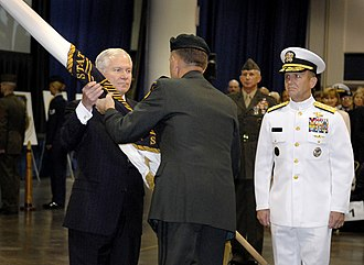 Bryan D. Brown - Gen. Brown hands over the USSOCOM flag to Secretary of Defense Robert Gates with Admiral Olson preparing to take charge of the command in 2007.
