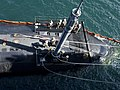 USS Santa Fe (SSN-763) loads a missile at Pearl Harbor on 20 May 2018 (180520-N-ZD021-0279).JPG
