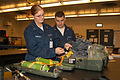 US Navy 040907-N-8770A-013 Aircrew Survival Equipmentman 3rd Class Delilah Johnson, left, of Canandaigua, N.Y., and Aircrew Survival Equipmentman 3rd Class Morgan Elliot, of Anchorage, Alaska, perform Planned Maintenance (PMS).jpg