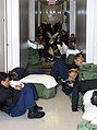 US Navy 040914-N-0000W-015 U.S. Navy students line the hall in a barracks while waiting to be evacuated from Naval Air Station Pensacola prior to Hurricane Ivan's arrival.jpg
