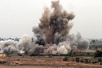 Second Battle of Fallujah - An air strike is called in on a suspected insurgent hideout in Fallujah.