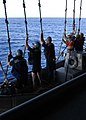 US Navy 041116-N-5384B-099 Crew members return to USS Abraham Lincoln (CVN 72) after completing a simulated man overboard and recovery drill.jpg