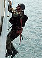 US Navy 050923-N-3019M-003 A Sailor assigned to the guided missile cruiser USS Cowpens (CG 63), climbs a ladder to board the ex-U.S. Coast Guard Cutter Yacona as part of a visit, board, search and seizure (VBSS) exercise.jpg