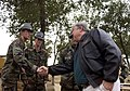 US Navy 051127-F-0692M-022 Governor of Mississippi, Haley Barbour shakes hands with U.S Navy Seabees at Chaklala Air Base, Pakistan.jpg