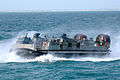 US Navy 060119-N-2736O-001 Landing Craft, Air Cushion (LCAC) 50 transits alongside the amphibious transport dock ship USS San Antonio (LPD 17), during a friends and family day cruise.jpg