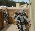 US Navy 060405-N-4097B-007 Sailors prepare to enter a simulated building while participating in the Navy's Individual Augmentee Combat Training course at Fort Jackson, S.C.jpg