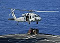 US Navy 060901-N-1598C-061 A MH-60S Knighthawk helicopter assigned to Helicopter Sea Combat Squadron Two Six (HSC-26) performs vertical replenishment operations.jpg