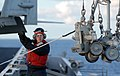 US Navy 070131-N-2959L-020 Fire Controlman 2nd Class Kenneth Breeden, from Corpus Christi, Texas, signals to the crane operator while sending two hand trucks to the NATO Sea Sparrow Missile platform.jpg