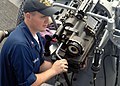 US Navy 070206-N-4973A-021 Electronics Technician 2nd Class Franklin performs routine maintenance on an MK-38, 25mm machine gun aboard guided missile destroyer USS O'Kane (DDG 77).jpg