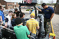 US Navy 070502-N-3271W-004 Special Warfare Boat Operator 2nd Class Andrew Everett gives students of Thomas Jefferson High School a tour on the Swift Boat that was displayed at the school.jpg