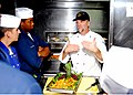 US Navy 070804-N-2638R-003 Civilian Culinary Instructor Jeff Hadley gives Culinary Specialists a demonstration on food presentation aboard Arleigh Burke-class guided-missile destroyer USS John S. McCain (DDG 56).jpg