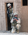 US Navy 071210-M-6020M-013 A Marine and a Sailor, both assigned to Marine Wing Support Squadron (MWSS) 374, clear a building in a simulated combat town during Desert Talon 1-08.jpg