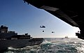 US Navy 071212-N-2984R-160 Two MH-60S Seahawks perform vertical replenishment during a replenishment-at-sea.jpg