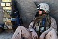 US Navy 071220-M-6159T-012 Lance Cpl. Jonathon N. Wise, assigned to K Co., 3rd Battalion, 3rd Marine Regiment, takes a rest break during a patrol through neighborhoods in Karamah, Iraq to interact with the residents and prevent.jpg