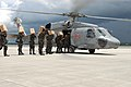 US Navy 080627-N-0640K-578 Service members assigned to the Philippine Army load an SH-60 Seahawk assigned to the.jpg
