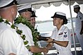 US Navy 080905-N-6674H-001 Cryptologic Technician (Information) 1st Class Amy Abellaneda, a chief selectee assigned to Navy Information Operations Command, Hawaii, receives a plaque at the graduation ceremony at the Battleship.jpg