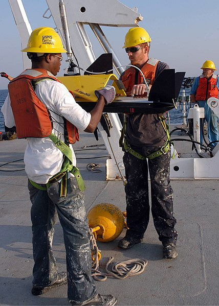 File:US Navy 080911-N-3970R-001 Merchant Marine Seaman Derrick Moore and Kyle Gibson prepare to launch a side-scan sonar.jpg