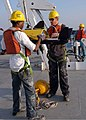 US Navy 080911-N-3970R-001 Merchant Marine Seaman Derrick Moore and Kyle Gibson prepare to launch a side-scan sonar.jpg