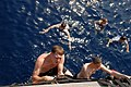 US Navy 081016-N-1635S-005 Sailors climb aboard the Ticonderoga-class guided-missile cruiser USS Chancellorsville (CG 62) during a scheduled swim call.jpg