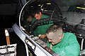 US Navy 081018-N-9610C-026 Aviation Structural Mechanic (Equipment) Airman Baxton Pickett and Aviation Structural Mechanic (Equipment) 1st Class Richard Harring repair the inside of an F-A-18F Super Hornet canopy.jpg