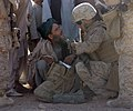 US Navy 081022-M-9389C-032 Hospital Corpsmen 3rd Class Edwin L. Daniel, assigned to 3rd platoon, Fox Company, 2nd Battalion 7th Marine Regiment, examines an Afghan citizen before dispensing aspirin while on a patrol in Helmand.jpg