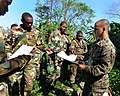 US Navy 090107-N-9995B-003 Sgt. Brian Rudolph hands out land navigation instructions to Jamaica Defense Force members during Southern Partnership Station.jpg
