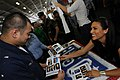 US Navy 090713-N-3659B-420 Television personality Leeann Tweeden gives an autograph to Aviation Support Equipment Technician Airman John Palacio during a USO Summer Troop Visit aboard the aircraft carrier USS Ronald Reagan (CVN.jpg
