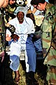 US Navy 100122-N-4378P-481 Sailors assist a Haitian man exiting an MH-60S Sea Hawk helicopter.jpg