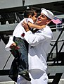 US Navy 100412-N-4774B-518 A Sailor assigned to the guided-missile cruiser USS Bunker Hill (CG 52) greets his son after returning from a three-month deployment.jpg