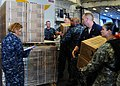 US Navy 100723-N-1531D-109 Sailors aboard USS Iwo Jima (LHD 7) stock MREs (Meals Ready to Eat) during preparation for an upcoming humanitarian assistance mission to Haiti.jpg