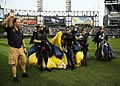 US Navy 100810-N-5366K-254 Members of the U.S. Navy parachute demonstration team, the Leap Frogs, wave to spectators after parachuting during the opening ceremony of a Chicago White Sox baseball game.jpg